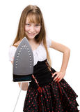 Teenage girl with electric iron Royalty Free Stock Images