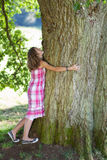 Teenage Girl Embracing Tree Royalty Free Stock Photography