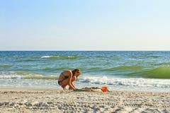 Teenage girl on an empty beach Stock Photos