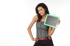Teenage girl with empty slate Stock Photo