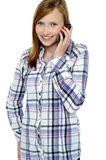 Teenage girl engaged in a conversation Royalty Free Stock Photography