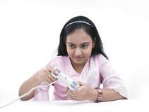 Teenage girl engrossed in gamming Stock Photography