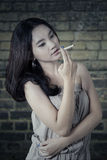 Teenage girl enjoy cigarette Royalty Free Stock Images