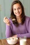 Teenage girl enjoy healthy cereal breakfast smile Royalty Free Stock Image