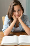 Teenage girl enjoy reading book at home Stock Image