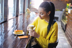 Teenage girl enjoying her coffee break Royalty Free Stock Photo