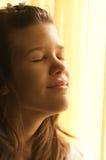 Teenage girl enjoying the morning sunshine Royalty Free Stock Images