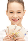 Teenage girl with euro cash money Royalty Free Stock Photos