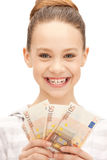 Teenage girl with euro cash money Stock Images