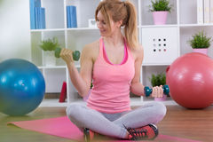 Teenage girl exercising with dumbbells Stock Image