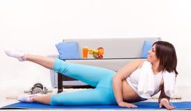 Teenage girl exercising home Stock Image