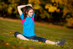 Teenage girl exercising outdoor Royalty Free Stock Images