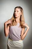 Teenage girl expressing dissatisfied emotion Royalty Free Stock Photos