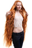 Teenage girl with extremely long red hair Stock Photos