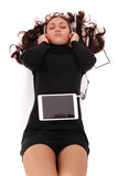 Teenage girl eyes closed lying on the floor with tablet pc and h Royalty Free Stock Photo
