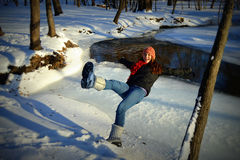 Teenage Girl Falling Into Frozen River Stock Photo