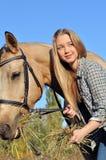 Teenage girl feeding horse Stock Photos