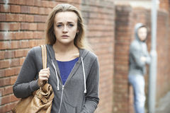 Teenage Girl Feeling Intimidated As She Walks Home. Girl Feeling Intimidated As She Walks Home Stock Photos
