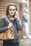 Teenage Girl Feeling Intimidated As She Walks Home. Girl Feeling Intimidated As She Walks Home stock photos