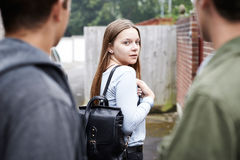 Teenage Girl Feeling Intimidated As She Walks Home. Teenage Girl Feels Intimidated As She Walks Home Royalty Free Stock Photos