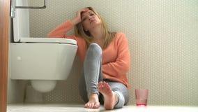 Teenage Girl Feeling Unwell In Bathroom stock video footage