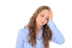 Teenage girl feels unwell. Portrait of an attractive teenage girl feeling unwell. All on white background Stock Photography