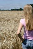 Teenage girl on field Royalty Free Stock Photo