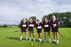 Teenage girl field hockey team Stock Photos