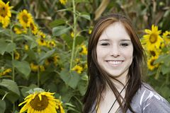 Teenage girl in a field of sunflowers Stock Photo