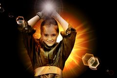 Teenage girl fighting with light. Teenage girl in front of a fireball fighting with light flashes royalty free stock photos