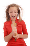 Teenage girl fights with toy snake, simulating  the fear of a snake Royalty Free Stock Image