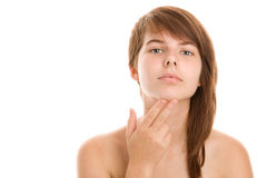 Teenage girl finding an acne Stock Image