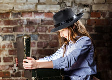 Teenage girl finding treasure inside a suitcase Stock Photos
