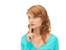 Teenage girl with finger on lips Royalty Free Stock Photos
