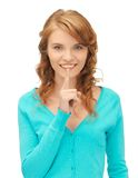 Teenage girl with finger on lips Stock Photography