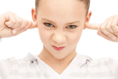 Teenage girl with fingers in ears Royalty Free Stock Image