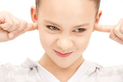 Teenage girl with fingers in ears Royalty Free Stock Photography