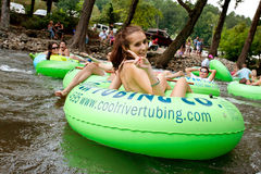 Teenage Girl Flashes Peace Sign While Tubing Down Georgia River Stock Photo