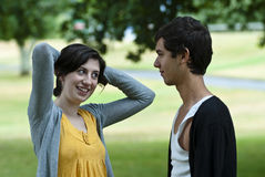 Teenage girl flirting with teenage boy Royalty Free Stock Photo