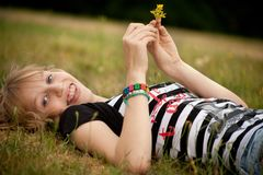 Teenage girl with a flower Royalty Free Stock Photo