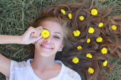 Teenage girl with flowers in hair Stock Photography