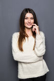Teenage girl with folded arms leaning Royalty Free Stock Photos