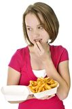 Teenage girl with french fries Royalty Free Stock Photos
