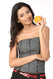 Teenage girl with fresh orange Royalty Free Stock Image