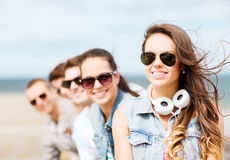 Teenage girl with friends outside Stock Images