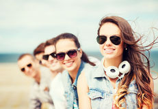 Teenage girl with friends outside Royalty Free Stock Photo