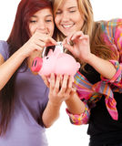 Teenage girl friends with piggy bank Stock Image