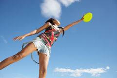 Teenage girl with frisbee. Teenage girl catching frisbee in the air stock photos