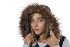 Teenage girl in fur jacket Stock Images