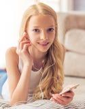 Teenage girl with gadget stock photos